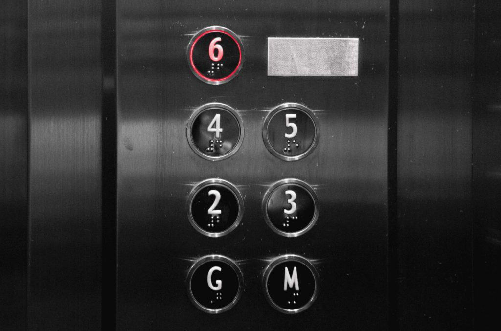 braille on elevator buttons below numbers so that bline people can use it easily